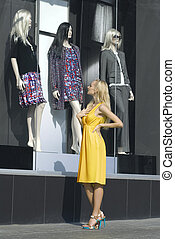 Blonde looks on the show-window - beautiful blonde looks on...