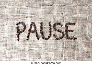 Pause spelled by coffee beans