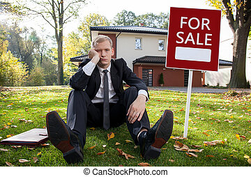 Worried estate agent - Worried real estate agent and house...