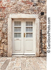 white classic door in ancient stone building - Old white...