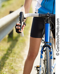 cyclist - Cropped view of female cyclist with hands on...