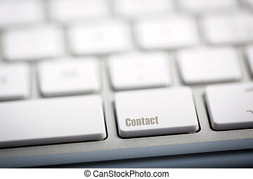 "The word ""CONTACT"" written on keyboard. - The word ""CONTACT""..."