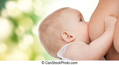 close up of mother breast feeding adorable baby -...