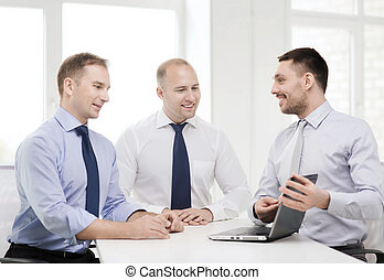 business team working with laptop in office - business and...