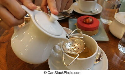Pouring Hot Tea into Cup
