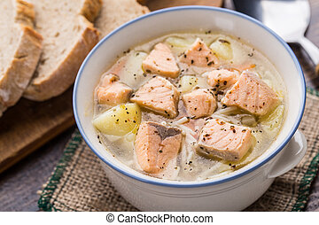 Fish soup in a bowl - Delicious salmon soup with noodles in...