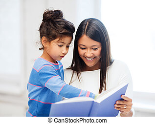 mother and daughter with book - family, children, education,...
