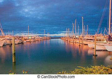 Marina at night, Tauranga New Zealand. - Between cloud layer...