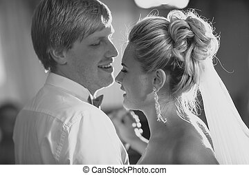 black and white portrait of bride and groom having first...