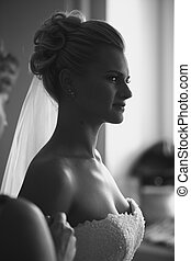black and white portrait of young beautiful bride at home -...