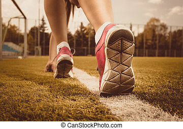 Toned photo of slim woman running on grass field - Toned...