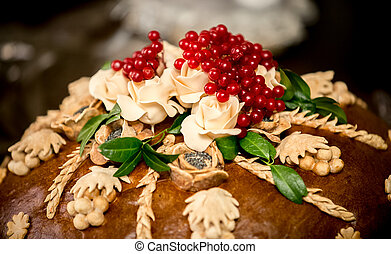 photo of traditional wedding bread decorated with berries -...