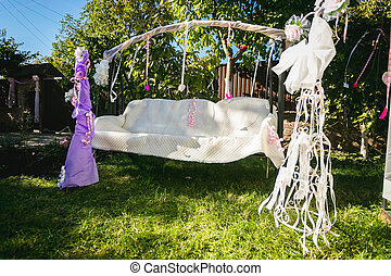 beautiful decorated for wedding swing at backyard - Outdoor...