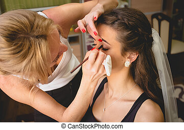 portrait of professional makeup artist applying mascara -...