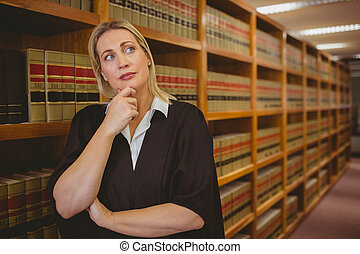 Serious lawyer thinking with hand on chin