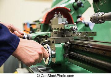 Engineering student using heavy machinery