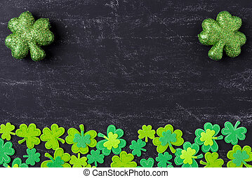 Green Clovers on Chalkboard Background Background for St...