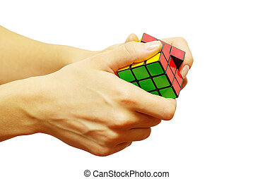 cube in hands - hands trying to resolve the puzzle