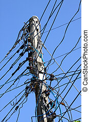 Electrical wire on pole. chaotic wire with nest on pole and...