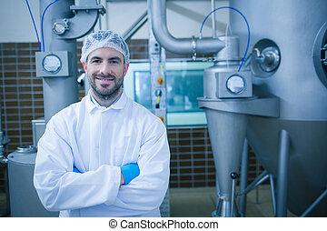 Food technician smiling at camera in a food processing plant...