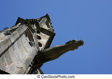 gargoyle - an ancient waterspout on a historic church...