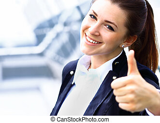 Happy smiling cheerful young business woman with okay...