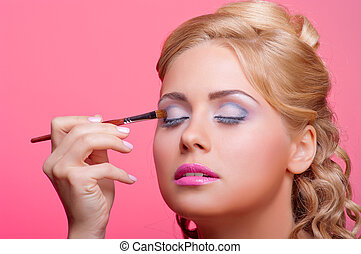 Young woman applying cosmetic paint brush - Beautiful young...