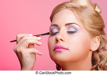 Beautiful woman applying cosmetic paint brush - Beautiful...