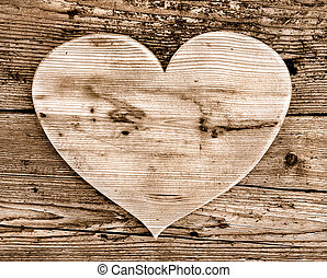 wooden heart - closeup on heart  on old wooden plank