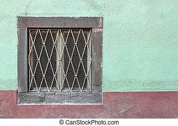 Wainscoting - An old window on a facade painted with unusual...