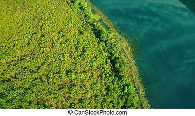 Brljan lake green beckground, aerial - Copter aerial view of...