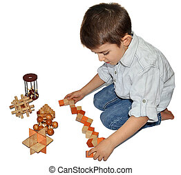 Wooden Brain Teaser - Boy with many wooden logic toys