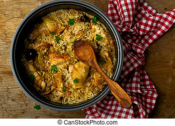 Stewed chicken with rice and dates in the crock-pot