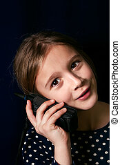 Teenager On a Cellular Phone - vertical portrait of a...