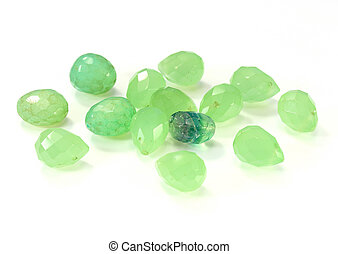 green emerald crystals on white