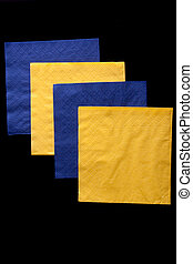 Napkins. - Blue and yellow napkins. Isolated on black.