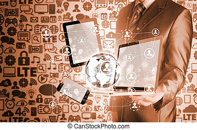 Business man using tablet PC and smartphone social...