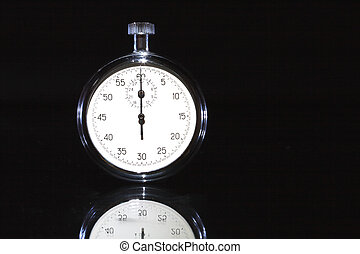 Stopwatch On Dark - Closeup of old stopwatch isolated on...