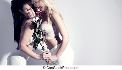 Two beautiful girls with flowers.