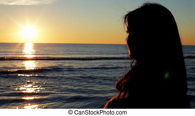 woman watching wonderful sunset