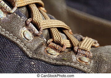 old used trekking shoes - close up image on classic used...