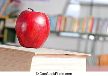 Back to school - Red apple on thick book