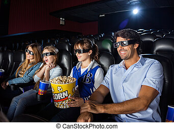 Happy Family Watching 3D Movie In Theater - Happy family of...