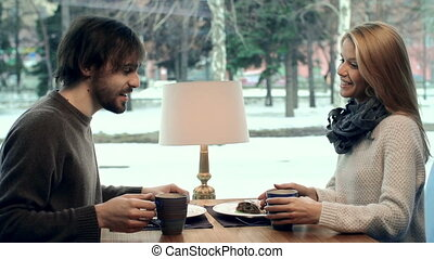 Romantic Tea Party - Close up of young couple at the...