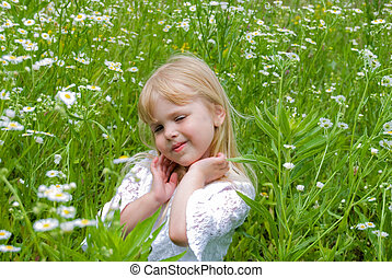 Outstanding - Little girl in a field of wild daisies.