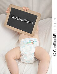 Baby with blackboard vaccination
