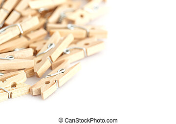 Wooden clothes peg isolated on white background