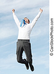 Business man jumping - A very happy business man jumping