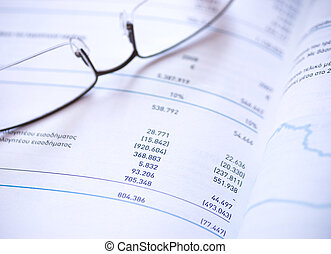Financial statement and eye glasses