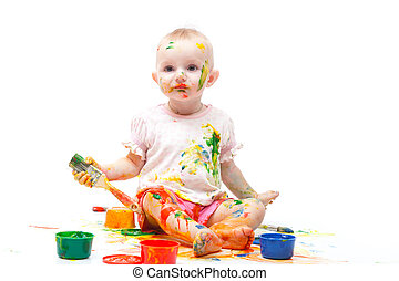 Little girl soiled by multi-colored paints on a white...